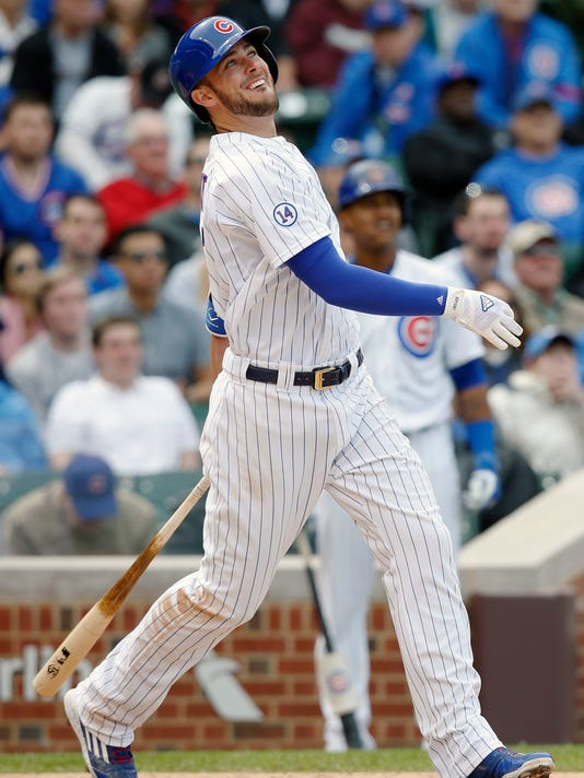 Chicago Cubs third baseman Kris Bryant (17) watches his RBI-single against the New York Mets during the fifth inning of a baseball game Thursday, May 14, 2015, in Chicago. (AP Photo/Andrew A. Nelles)