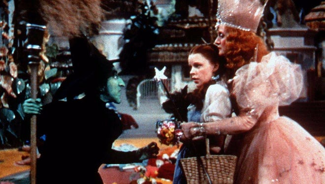 """The Wicked Witch of the West, left, played by Margaret Hamilton, confronts Dorothy, played by Judy Garland, and Glinda, the Witch of the North, played by Billie Burke, right, in """"The Wizard of Oz."""""""