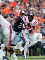 Auburn defensive back Daniel Thomas (24) tackles Ole Miss wide receiver Van Jefferson (12) as he catches a pass during the NCAA football game between Auburn and Ole Miss on Saturday, Oct. 7, 2017, in Auburn, Ala.