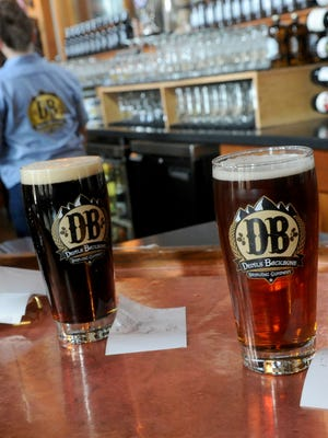 Glasses of beer are left on the bar for the waitress to take to the customer who placed the order during lunch at Devils Backbone Brewing Company in Nelson County on Friday, Feb. 8, 2013.