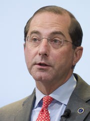 In this Oct. 26, 2018, file photo Health and Human Services Secretary Alex Azar speaks at the Brookings Institute in Washington. The Trump administration says it is moving ahead with a plan to let patients directly receive prescription drug discounts negotiated behind-the-scenes between drugmakers, middlemen, and insurers. Azar said Thursday, Jan. 31, 2019, the proposed regulation would encourage the major industry players to channel any such discounts to consumers when they purchase their prescriptions.