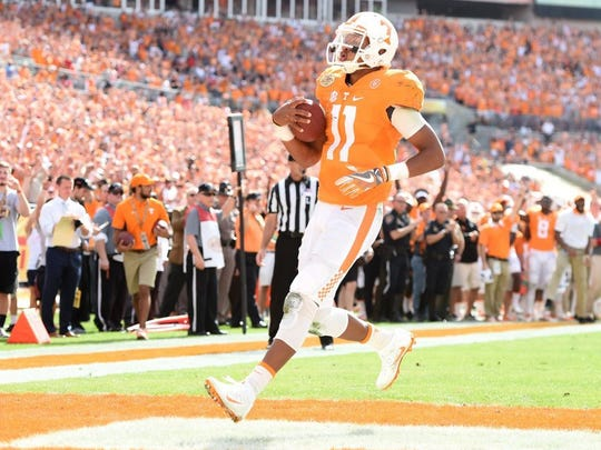 Tennessee quarterback Joshua Dobbs (11) jogs into the