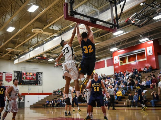 Elco's Colton Lawrence dunks the ball against Berks