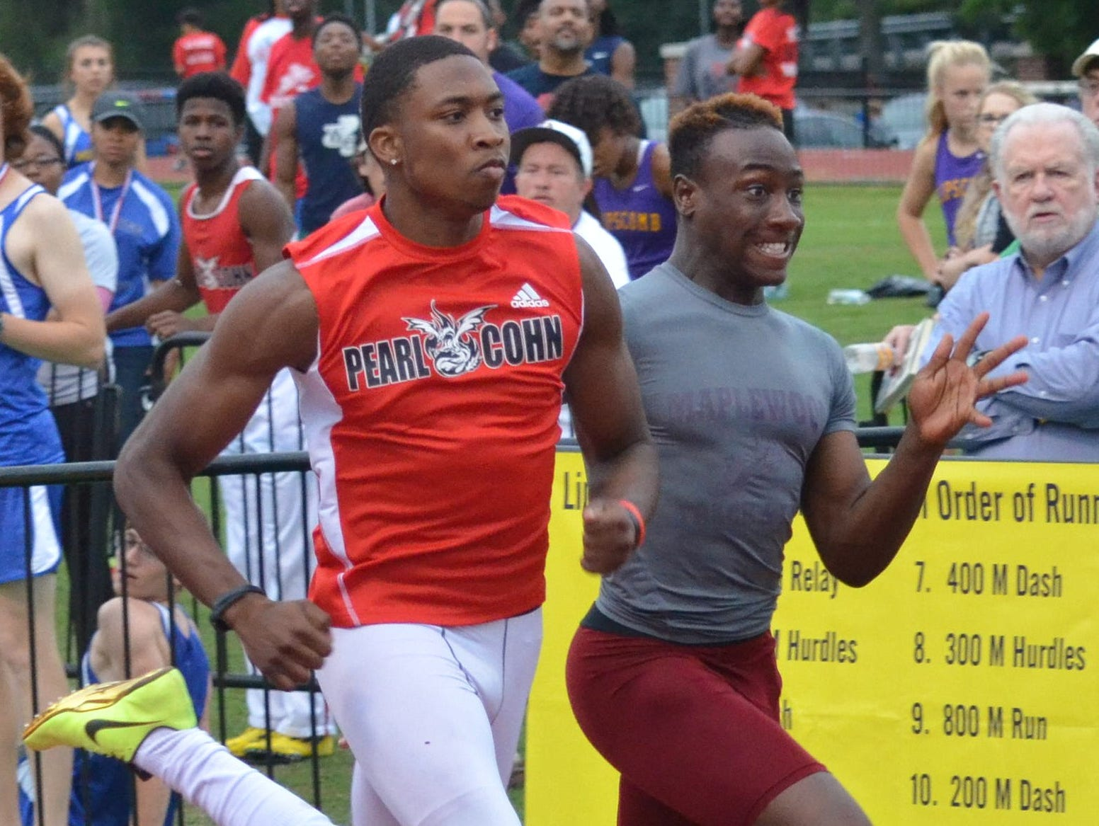 Pearl-Cohn senior Cameron Watkins, left, won the 100-meter dash Thursday in 10.94 seconds, edging Maplewood's Corey Simmons by two one-hundredths of a second.