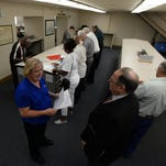 People fill out paperwork last week at the Caddo clerk of court's office in Shreveport to qualify for elections set Nov. 4.