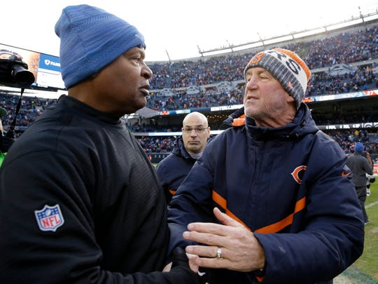 FILE- In this Sunday, Nov. 19, 2017, file photo, Detroit Lions head coach Jim Caldwell and Chicago Bears head coach John Fox greet each other after an NFL football game in Chicago. The Lions won 27-24. Both coaches will be leaning on their quarterbacks, Matthew Stafford and Mitchell Trubisky, to make all the right moves on Saturday in Detroit. (AP Photo/Nam Y. Huh, File)