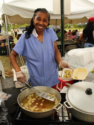 Mary Smith of Hayneville was busy selling fried okra at Saturday's annual festival. Alvin Benn/Special to the Advertiser