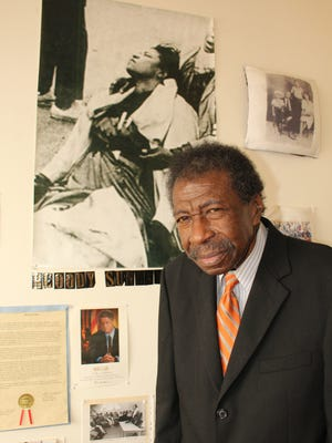 Selma lawyer Bruce Boynton stands below the photo of his mother, Amelia Boynton, who was beaten on the Edmund Pettus Bridge in 1965. Alvin Benn/Special to the Advertiser