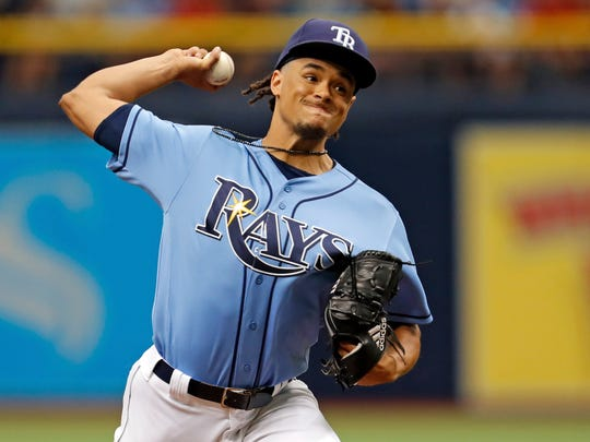 Tampa Bay Rays starting pitcher Chris Archer throws during the first inning of a baseball game against the Boston Red Sox, Sunday, July 9, 2017, in St. Petersburg, Fla. (AP Photo/Mike Carlson)