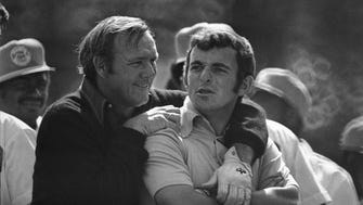 Arnold Palmer, left, puts his arm around Tony Jacklin, of England, as they wait to tee off for The Masters Par 3 Contest on April 5, 1972 at the Augusta National Golf Club in Augusta, Ga.