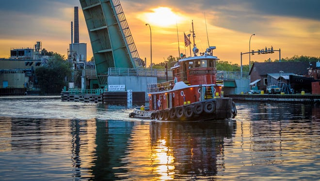 The Manitowoc Area Visitor & Convention Bureau 2014 photo contest first place winner Bill Pohlmann in lakeshore-nautical-scenery category with the photo Evening Passage taken of a tugboat on the Manitowoc River. This photo took top honors as the overall best in show.