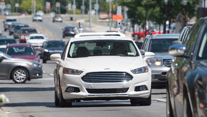 Ford tests an autonomous Fusion recently in Dearborn. The automaker plans to bypass semi-autonomous driver-assist systems in its quest for fully driverless vehicles by 2021.