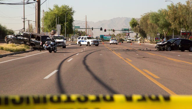 The Phoenix Police Department investigates a fatal collision on 67th Avenue just north of Buckeye Road on May 23, 2017.