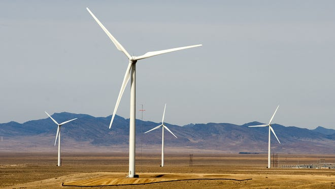 Wind turbines turn at the First Wind Milford Wind Corridor project in southwest Utah.
