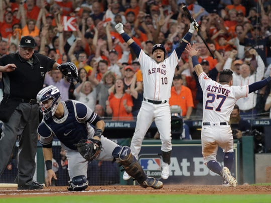 Houston Astros' Jose Altuve reacts after scoring the