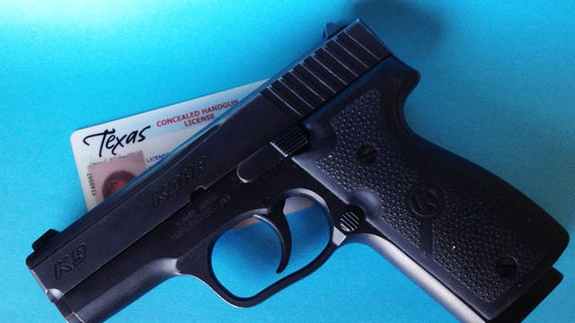 A Kahr K-9 9mm semi-automatic pistol owned by a Texas concealed handgun license carrier.