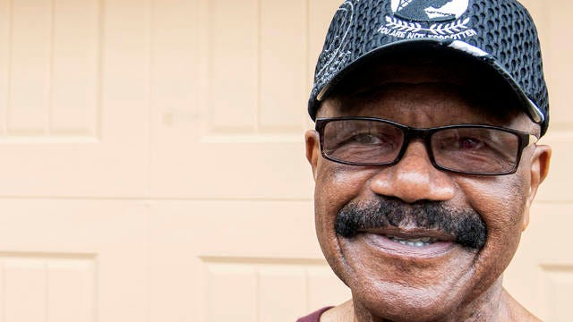 In this Thursday, Dec. 26, 2019, photo, Memphis native Lt. Col. James Williams, who was a prisoner of war in Vietnam, poses for a portrait in front of his sister's home in Cordova. Williams and other veterans returned to Hanoi, Vietnam, to gain closure from their time at war. Williams connected with a Valor Administration representative who notified him of the trip to Vietnam, a golden opportunity to complete part of his living list.