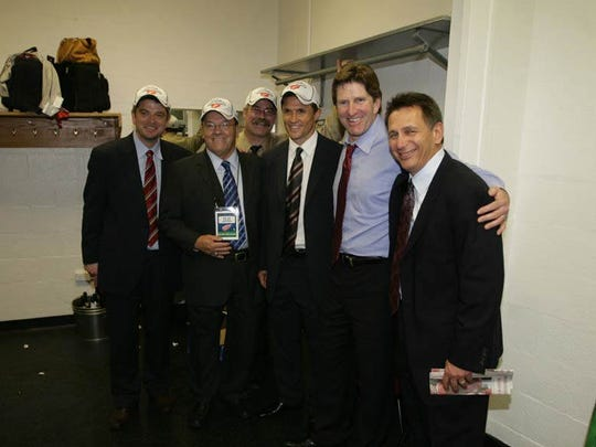 The Red Wing brain trust in the locker room after defeating the Penguins 3-2 in Game 6 of the Stanley Cup Finals, Wednesday, June 4, 2008 at the Mellon Arena in Pittsburgh, Penn. Todd Mclellan, Red Wings assistant coach, Scotty Bowman, Paul MacLean Wings assistant coach, Steve Yzerman, Mike Babcock and Ken Holland.