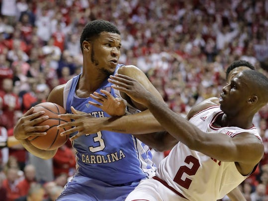 North Carolina's Kennedy Meeks (3) grabs a rebound from Indiana's Josh Newkirk (2) during the second half of an NCAA college basketball game Wednesday, Nov. 30, 2016, in Bloomington, Ind. Indiana defeated North Carolina 76-67. (AP Photo/Darron Cummings)