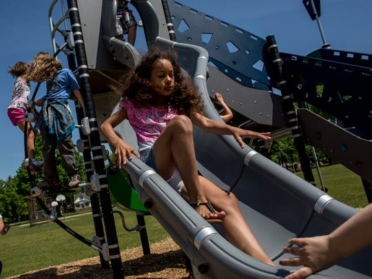 Fourth-grade student Sharai Martin, 9, slides down new playground equipment Tuesday, May 31, 2016 at Crull Elementary School in Port Huron. The Crull PTA raised $15,000 over three years, and received a $15,000 match from a local business to pay for the equipment.