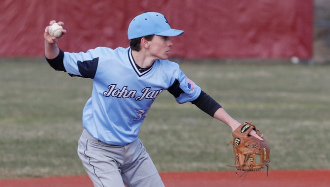 John Jay-East Fishkill's Kyle Cacamisse looks to turn a double play in a game against Arlington last year.
