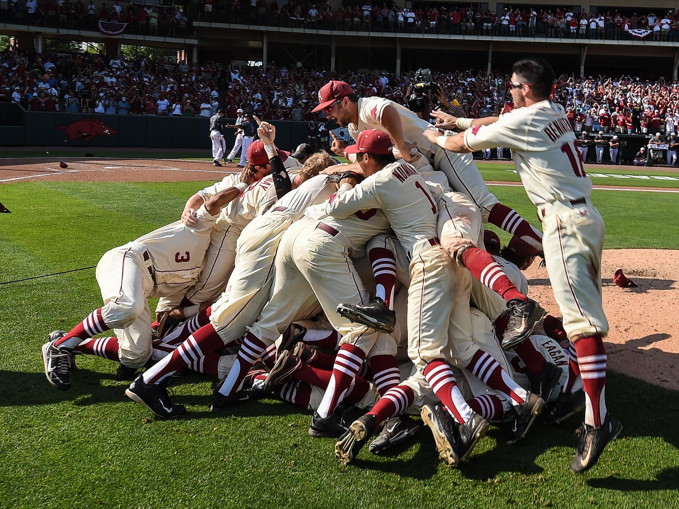 Post game celebration on Sunday, during the Fayetteville Super Regional game 3 between Arkansas and Missouri State at Baum Stadium. Arkansas won the game 3-2.