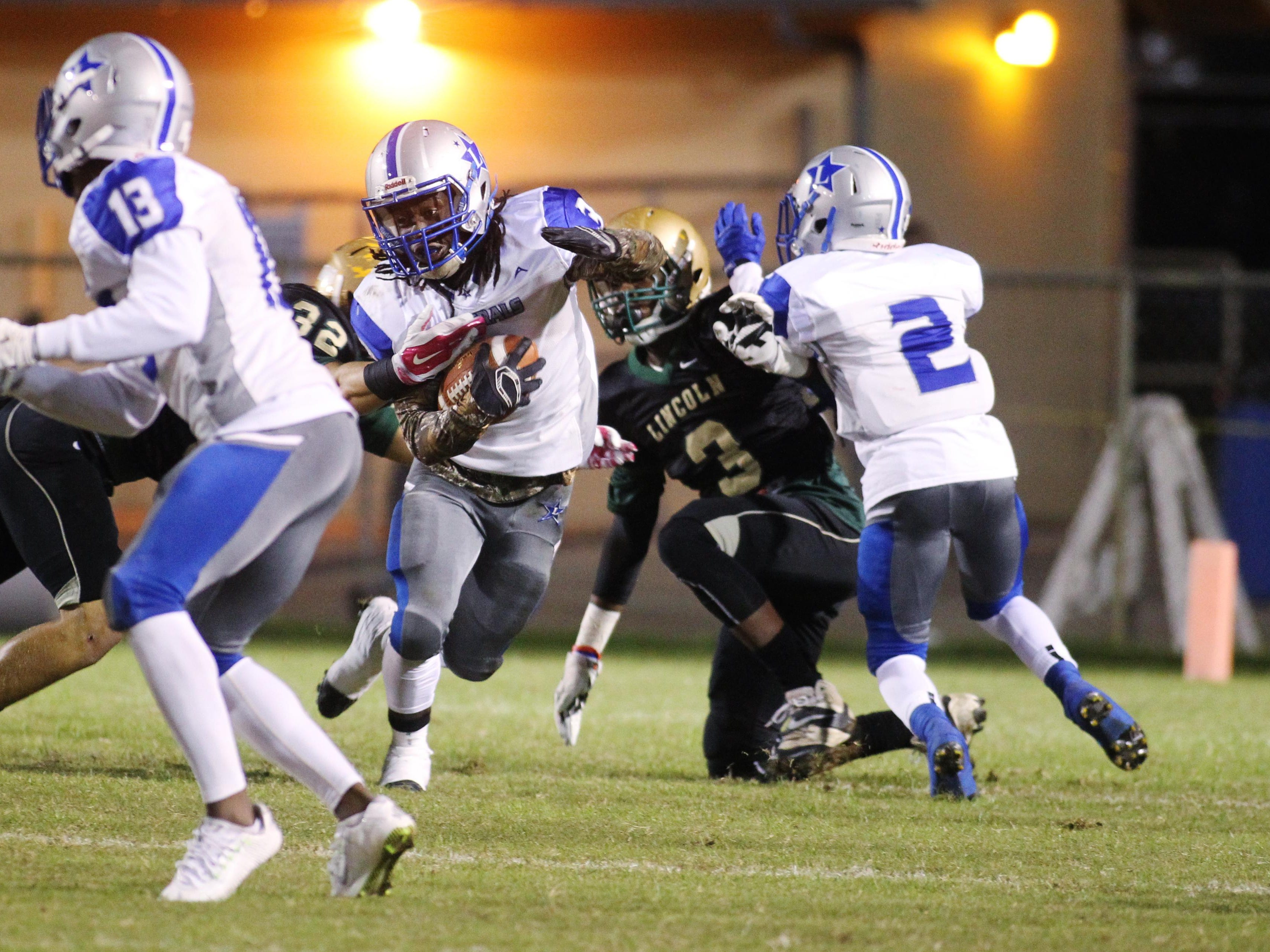 Lee's Tony Belle rushed for 176 of the Generals' 308 yards of rush offense, but Lincoln forced an overtime stop in overtime, leading to a 44-41 in the first round of the Class 7A playoffs.