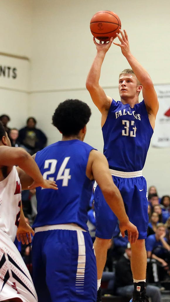 Cedar Crest's Evan Horn (33) hits a three pointer against McCaskey during first half action of an LL section 1 showdown at McCaskey High School Friday December 18, 2015. (Photo/Chris Knight)