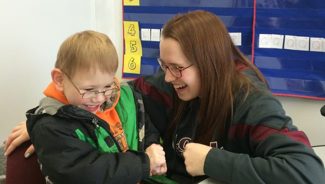 Ayden Schoonover and his mom Lindsey share a laugh during an interview at Loyal Elementary School on Friday.