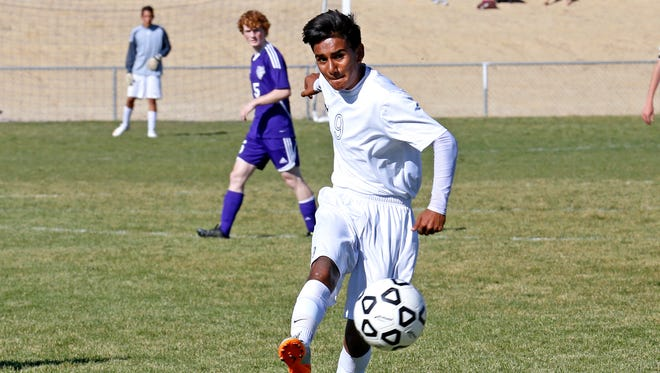 Piedra Vista's Victor Alba kicks the ball downfield during an Oct. 14 match against Miyamura at the Piedra Vista High School soccer fields in Farmington.