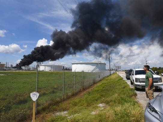 Smoke and fire rise from a heavy oil tank at Valero's