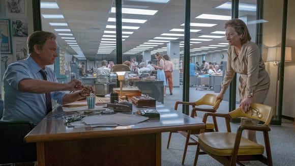 Tom Hanks portrays Ben Bradlee, left, and Meryl Streep portrays Katharine Graham in a scene from 'The Post.'
