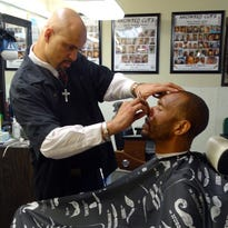 Cutting hair is the last thing on barber Jemar Harris' mind