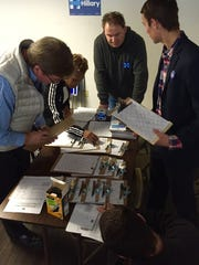 Volunteers began preparing a canvassing strategy for Wilmington Sunday.