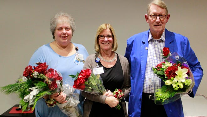 From left: Nicole Claus, RN, staff instructor, Staff Development;Dorothy Gregg, food service manager, Nutritional Services Department; and Don Bone, volunteer.
