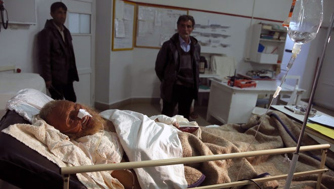 An avalanche survivor lies on a bed at Emergency Hospital in Panjshir province north of Kabul, Afghanistan, Wednesday, Feb. 25, 2015. Avalanches caused by a heavy winter snow killed at least 124 people in northeastern Afghanistan, an emergency official said Wednesday, as rescuers clawed through debris with their hands to save those buried beneath.