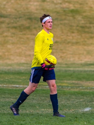 Snow Canyon keeper Quinn Hargis (98) looks downfield after saving a goal during the game at Canyon View, Tuesday, Mar. 21, 2017, in Cedar City, Utah.