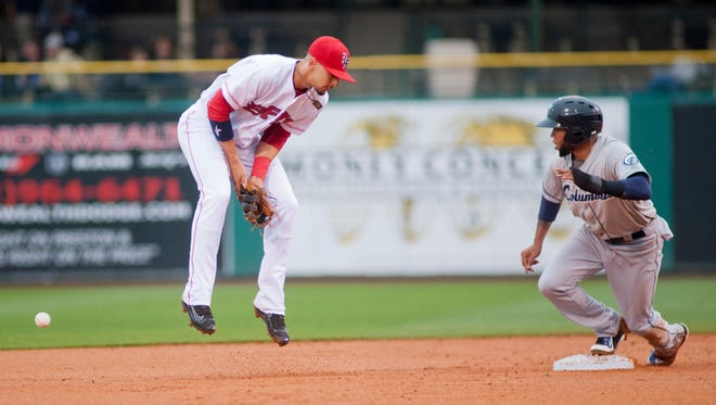 Columbus Clippers' Erik Gonzalez steals second base and moves on to 3rd base on an errant throw by Louisville Bats' Chris Berset to Louisville Bats shortstop Jose Peraza in the top of the 2nd inning.20 May, 2016