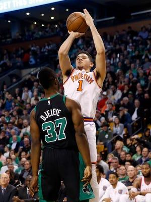 Dec 2, 2017: Phoenix Suns guard Devin Booker (1) shoots over Boston Celtics forward Semi Ojeleye (37) during the second half at TD Garden.