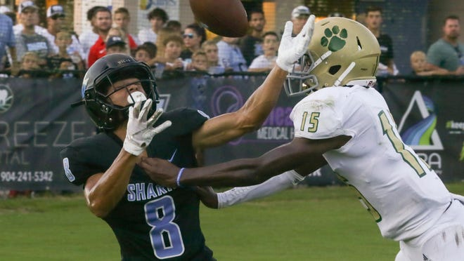 Nease safety Joshua Ealey (15) breaks up a pass intended for Nease wide receiver Noah Washington during the second quarter of the Battle for the Bridge on Friday, Aug. 23, 2019. Nease and Ponte Vedra are scheduled to open the 2020 season against each other on Aug. 21.