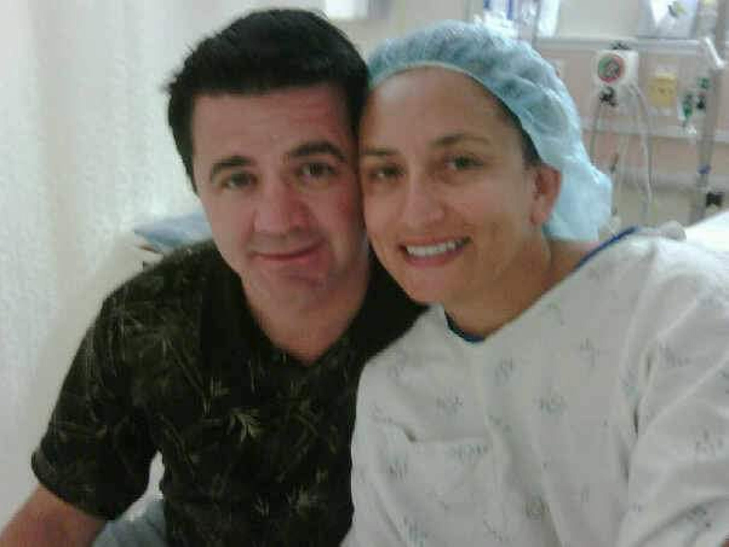 Claudia Ortega-Lukas and her husband Tim Lukas pose for a photo while in the hospital.