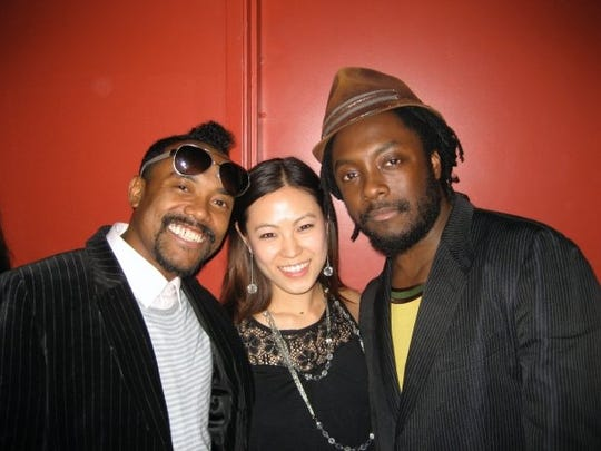 apl.de.ap of the Black Eyed Peas, Hannah Cho Iriarte, and Will.i.am of the Black Eyed Peas smile for a photo.