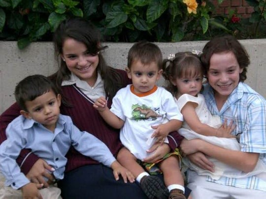 left to right: Carlos Tapia, Gabriela Bastidas, Nicolas Tapia, Sofia Bastidas and content producer Jose Bastidas, pose for a photo after Gabriela's Confirmation ceremony in 2007.