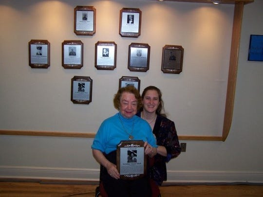 Rita Juanita Mock poses with her late grandmother, Jerrie Mock in 2007. A Newark native, Mock became the first woman to fly solo around the world in 1964. Her granddaughter has written a play about her that will premiere in Chicago this summer.