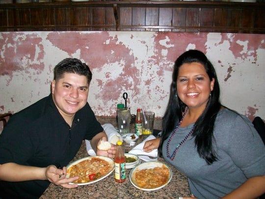 Krystle and her husband, Carlos, enjoy crawfish etouffee in New Orleans.