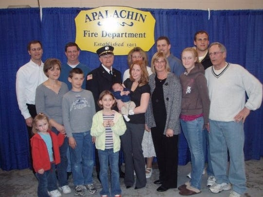 Bob Squier celebrates 50 years in the Apalachin Fire Department with family.