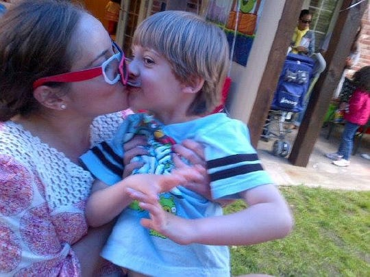 Parenting columnist says to kiss your children.