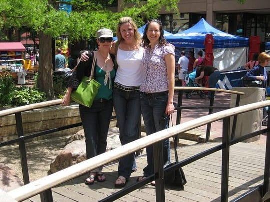 Marjorie Eastman, center, with friends Laura Verbryck, left, and Jennifer Barroll in 2008 in Boulder, Colo., where Eastman was going to graduate from school between stints on active duty.