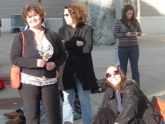 Teree Olsen of Vancouver Island, British Columbia (left) with fellow Dylan fans waiting for a Dylan concert outside of the WaMu Theater in Seattle.