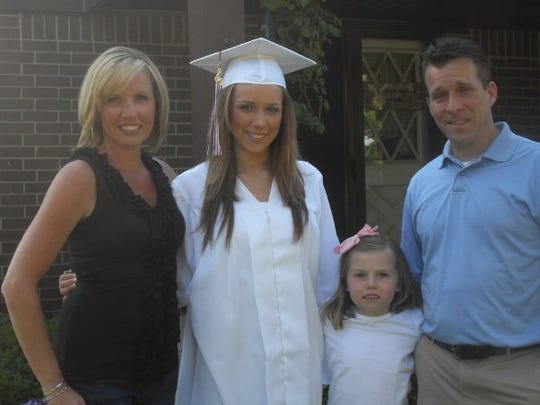 Brittany Sherfield with her family at her high school graduation.